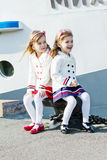 Two little happy girls in port Stock Photos