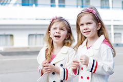 Two little happy girls in port Royalty Free Stock Photos