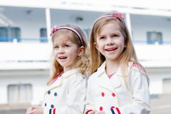 Two little happy girls in port Royalty Free Stock Photography