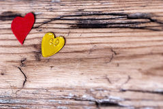 Two little Hearts on Wooden Plank Stock Image