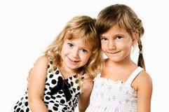 Two little hugging girlfrends isolated Royalty Free Stock Photos