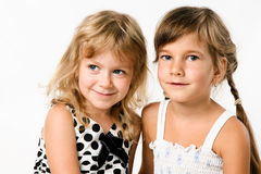Two little hugging girlfrends isolated Royalty Free Stock Photography