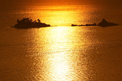 Two little islets on the Adriatic Sea. Katic and Sveta Nedelja, Two little islets on the Adriatic Sea, near the town of Petrovac, at sunset Royalty Free Stock Photography