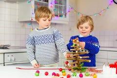 Two little kid boys decorating Christmas tree Stock Image