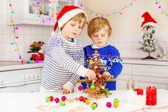 Two little kid boys decorating Christmas tree Stock Photo