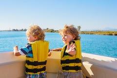 Two little kid boys enjoying sailing boat trip Stock Photography