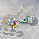 Two little kid boys with excavator chalk picture Stock Images