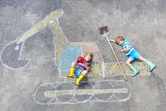 Two little kid boys with excavator chalk picture Royalty Free Stock Photo