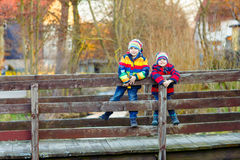 Two little kid boys outdoors in spring town Royalty Free Stock Images
