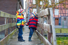 Two little kid boys outdoors in spring town Stock Photos
