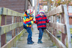 Two little kid boys outdoors in spring town Stock Photo