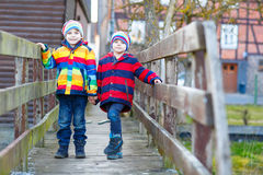 Two little kid boys outdoors in spring town Royalty Free Stock Photo
