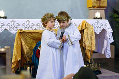 Two little kid boys playing angels of Christmas story in church Royalty Free Stock Photos