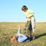 Two kids playing and exercising yoga on meadow stock photos