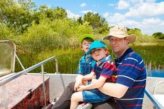 Two little kids boys and father making air boat tour in Everglad. Two little kids boys and father making air boat tour in Florida wetland swamp at Everglades Stock Photography