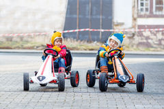 Two little kids boys having fun with toy race cars Stock Image