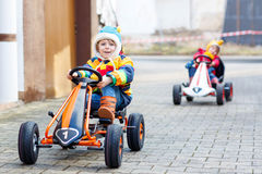 Two little kids boys having fun with toy race cars Stock Photos