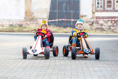 Two little kids boys having fun with toy race cars Royalty Free Stock Image