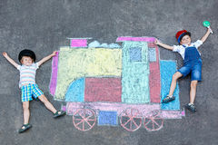 Two little kids boys having fun with train chalks picture Royalty Free Stock Photography