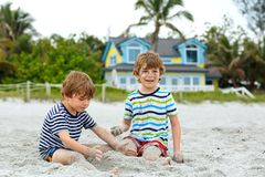 Two little kids boys having fun on tropical beach Royalty Free Stock Images