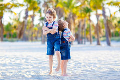 Two little kids boys having fun on tropical beach Stock Images