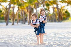Two little kids boys having fun on tropical beach Royalty Free Stock Photos