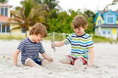Two little kids boys having fun on tropical beach Royalty Free Stock Photos
