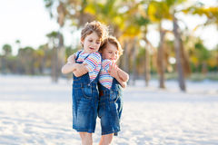 Two little kids boys having fun on tropical beach Royalty Free Stock Image