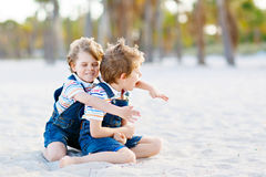 Two little kids boys having fun on tropical beach Stock Photo
