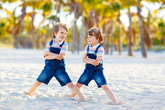 Two little kids boys having fun on tropical beach Royalty Free Stock Image