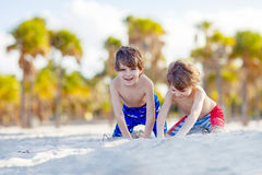 Two little kids boys having fun on tropical beach Royalty Free Stock Photo