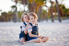 Two little kids boys having fun on tropical beach Stock Photo
