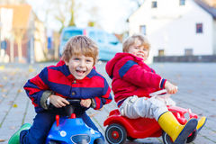 Two little kids boys playing with toy cars, outdoors Royalty Free Stock Photography