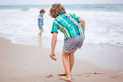 Two little kids boys running on the beach of ocean Royalty Free Stock Images