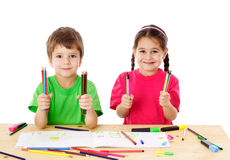 Two little kids with color pencils Royalty Free Stock Photos