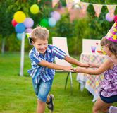 Two little kids dancing roundelay. Two little kids celebrating birthday dancing roundelay Stock Image