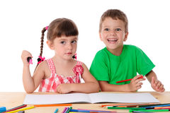 Two little kids draw with crayons Royalty Free Stock Image