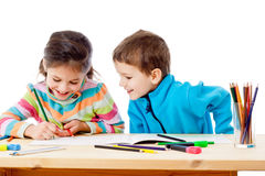 Two little kids draw with crayons Stock Image