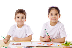 Two little kids draw with watercolor Stock Photos