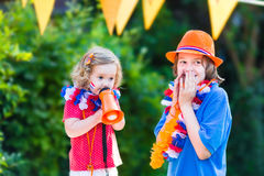 Two little kids Dutch football supporters Royalty Free Stock Photos