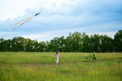 Two little kids fly a kite Royalty Free Stock Photos