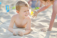 Two little kids having fun on a beach Stock Photography