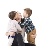 Two little kids having fun with their mother Stock Image