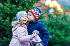 Two little kids hugging on Christmas market Stock Photo