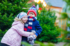 Two little kids hugging on Christmas market Royalty Free Stock Photo