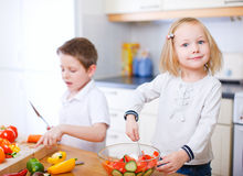 Two little kids making salad Stock Photo