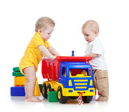 Two little kids playing with color toys royalty free stock images