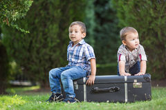 Two little kids playing in the park. Two brothers playing in the park Royalty Free Stock Photos