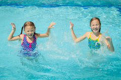 Two little kids playing in the pool Royalty Free Stock Image