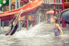 Two little kids playing in the swimming pool Royalty Free Stock Image